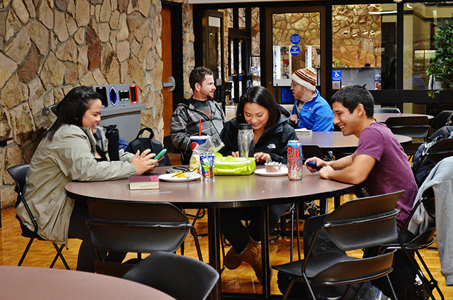 Students enjoy lunch in the cafeteria and socialize together in a safe atmosphere.