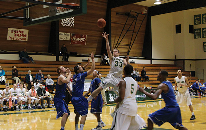 Zach Ginter released a floater as he penetrated Lane's defense, scoring 13 of Umpqua's 64 points Wednesday night.