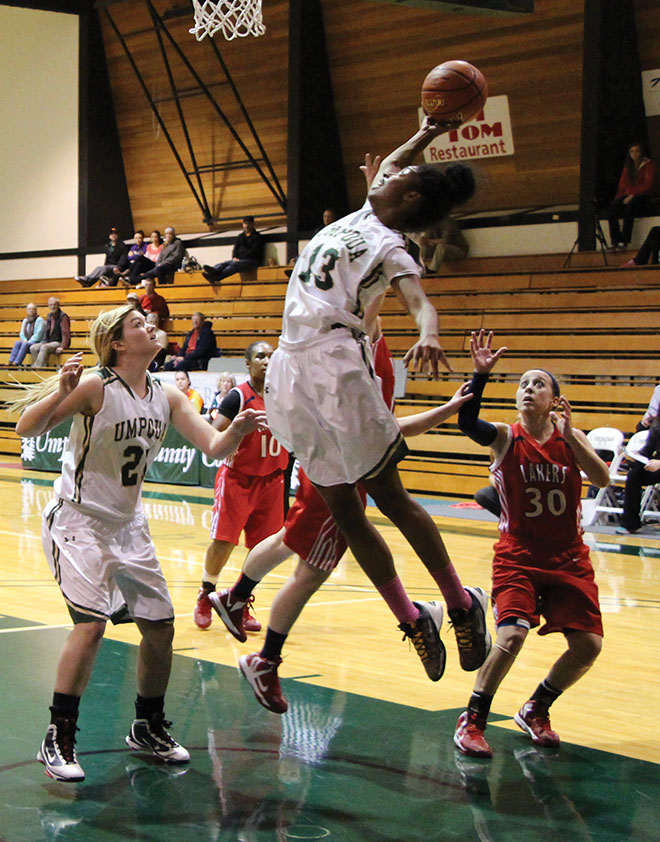 Christal Jeff soars past SWOCC defenders on her way to the hoop.