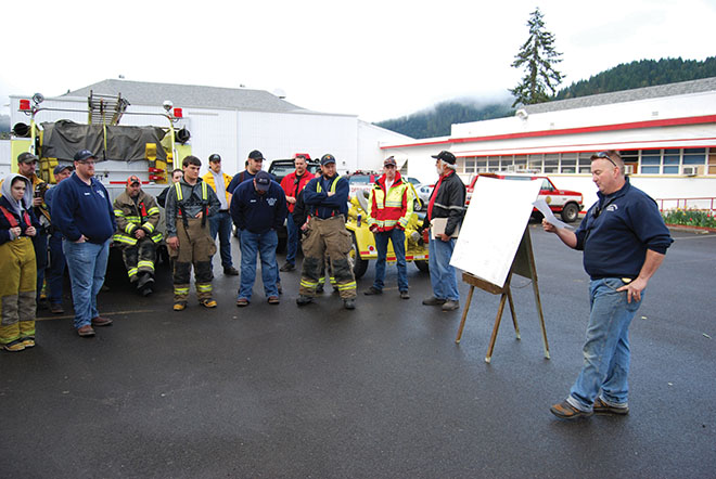 Days Creek Fire Chief Kyle Ward instructs his crew
