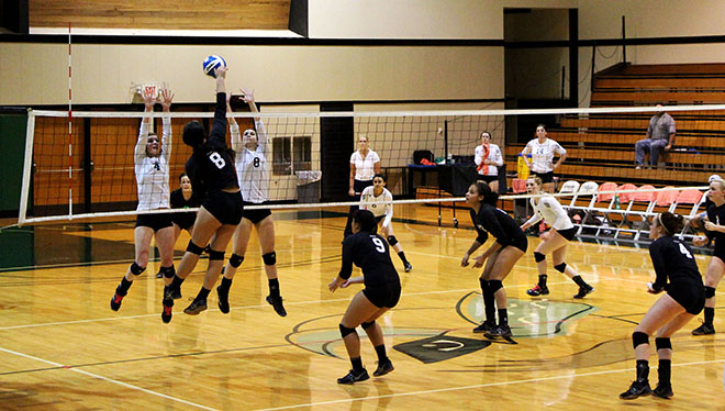 Kathryn Epler(4) and Kelsey Warren (8) attempt to block a hit as Danae Perkey, Elysha Lang, and Jocelyn Vallencia cover the court.