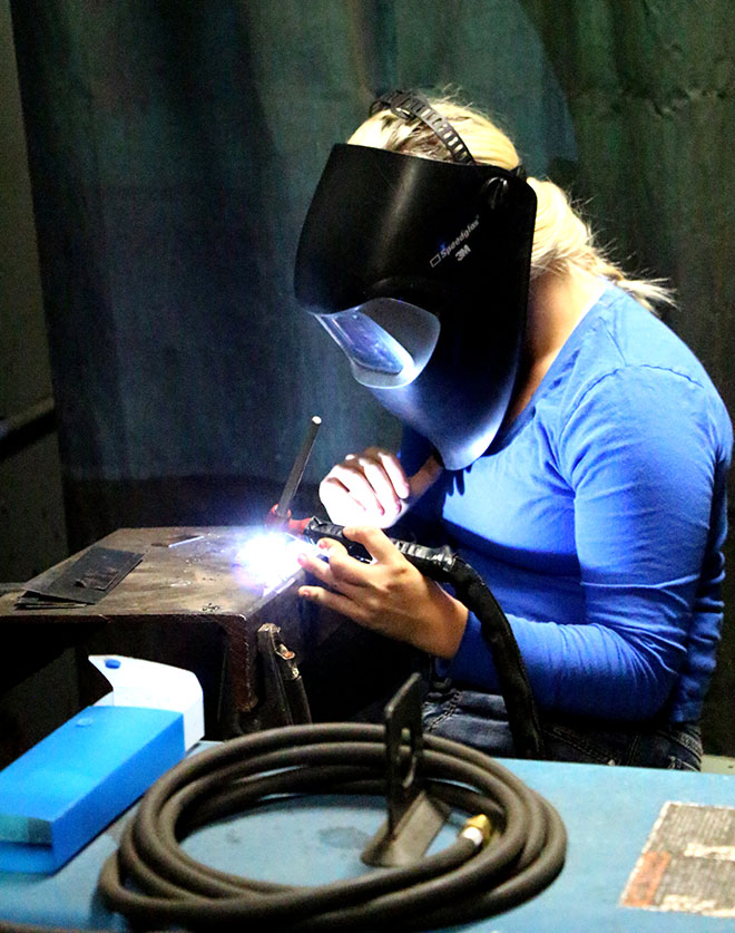 Jessica Powell practices her skills during a welding class at UCC. Many students have found  employment opportunities as welders in Douglas County and Oregon following graduation.