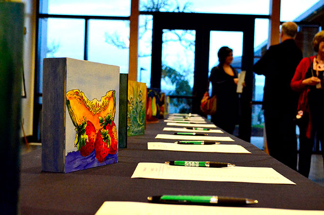 A silent art auction, held Feb. 13, raised $3,440 for the new Veterans Center. Artist Linda Aman, wife of UCC Vice President of Student Services Rick Aman, donated 30 paintings which she painted in 30 days.