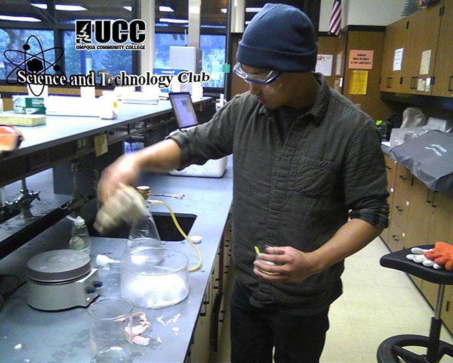 Ben Chu works with dry ice and CO2 gas in Science club, showing that carbon dioxide is denser than air.